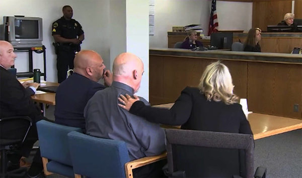 [IMAGE] Defense attorney Rachel Forde puts a hand on William Talbott after the guilty verdict is read (KIRO-TV)